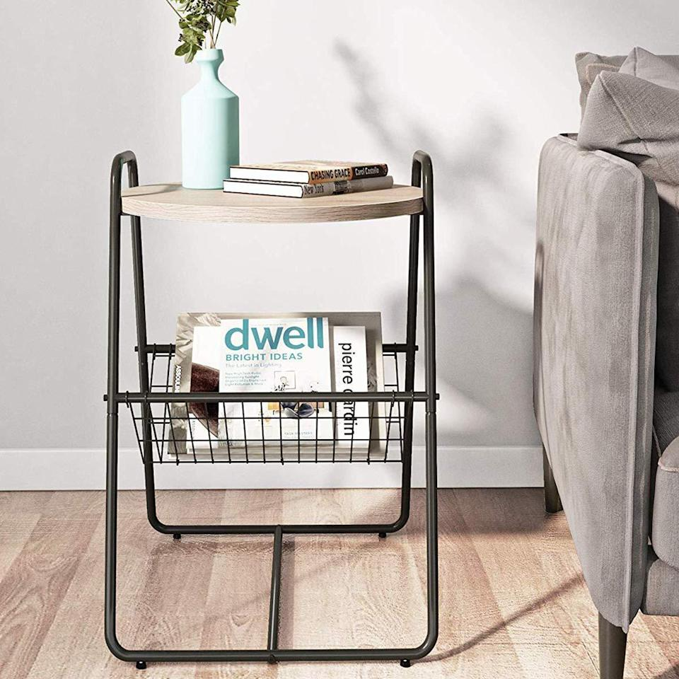 "<h3>Homemaxs Side Table With Storage Basket</h3><br><strong>When you don't actually have a living room:</strong> Tuck this small-space version of a side table and bookshelf combo beside a compact love seat to create your own studio apartment-style, ""living room.""<br><br><strong>Homemaxs</strong> Side Table With Metal Storage Basket, $, available at <a href=""https://amzn.to/2QT0c5t"" rel=""nofollow noopener"" target=""_blank"" data-ylk=""slk:Amazon"" class=""link rapid-noclick-resp"">Amazon</a>"
