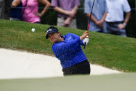 Lizette Salas of the US hits out of the green side bunker on the sixth hole during the third round of play in the KPMG Women's PGA Championship golf tournament Saturday, June 26, 2021, in Johns Creek, Ga. (AP Photo/John Bazemore)