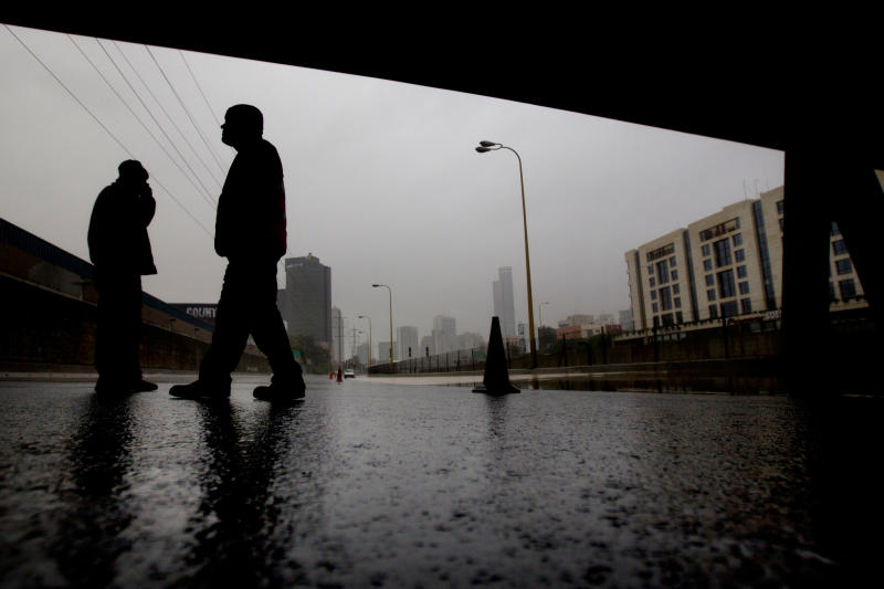 Israeli Police officers block the flooded Ayalon freeway in Tel Aviv, Israel,Tuesday, Jan. 8, 2013. Heavy rains flooded Tel Aviv. (AP Photo/Ariel Schalit)