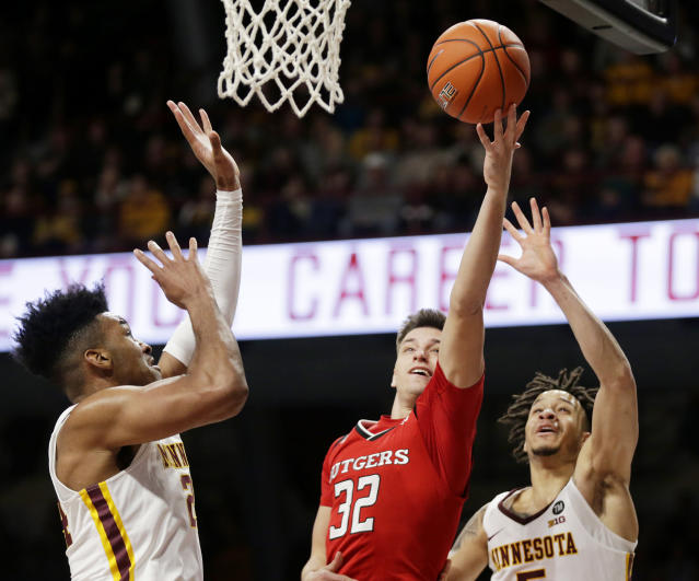 Rutgers guard Peter Kiss (32) shoots between Minnesota guard Amir Coffey (5) and Minnesota guard Marcus Carr (2) during the second half of an NCAA college basketball game Saturday, Jan. 12, 2019, in Minneapolis. Minnesota defeated Rutgers 88-70. (AP Photo/Andy Clayton-King)