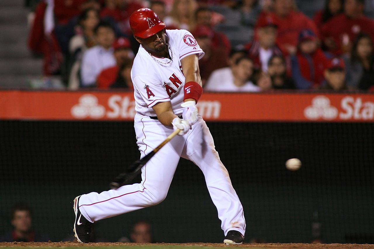 ANAHEIM, CA - JUNE 15:  Albert Pujols #5 of the Los Angeles Angels of Anaheim lines to third base against the Arizona Diamondbacks for the first out in the ninth inning at Angel Stadium of Anaheim on June 15, 2012 in Anaheim, California.  (Photo by Jeff Golden/Getty Images)