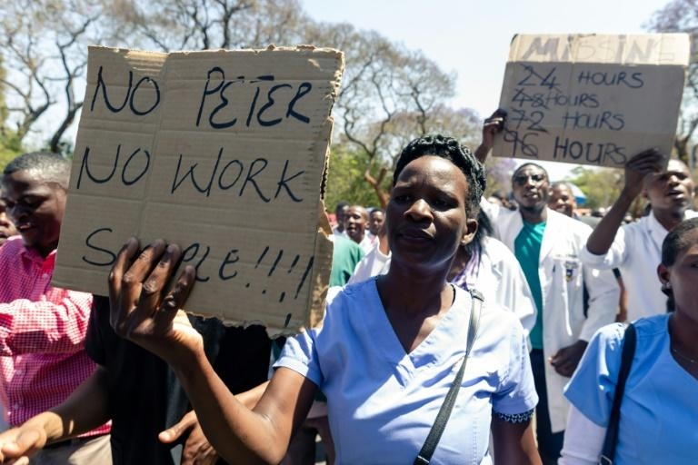Demonstrator believe Dr Peter Magombeyi was taken because of his role in organising strikes to demand better pay and working conditions (AFP Photo/Jekesai NJIKIZANA)