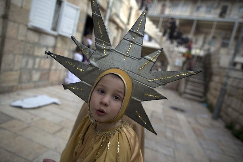 An Ultra-Orthodox Jewish boy wears a Purim costume as he celebrates the Jewish festival of Purim on February 25 2013 in the religious neighborhood of Mea Shearim in Jerusalem. (Menahem Kahana/AFP/Getty Images)