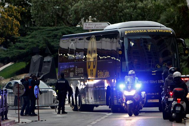 <span>A police escort took the Dortmund bus to the stadium</span> <span>Credit: AP </span>