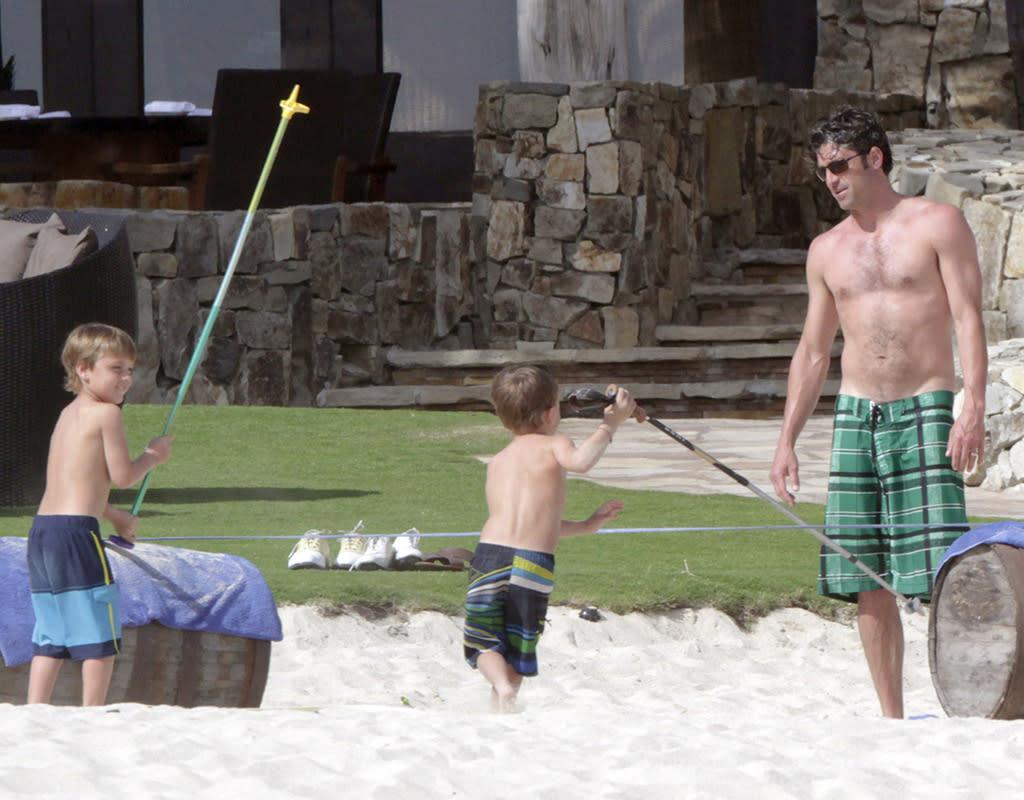 "They don't call him McDreamy for nothing! ""Grey's Anatomy"" star Patrick Dempsey played with his 6-year-old twin boys, Sullivan and Darby, when the 47-year-old and his fam spent Easter week at Cindy Crawford and hubby Rande Gerber's home in Cabo. We're going to guess they were pretty nice digs! (3/31/2013)"