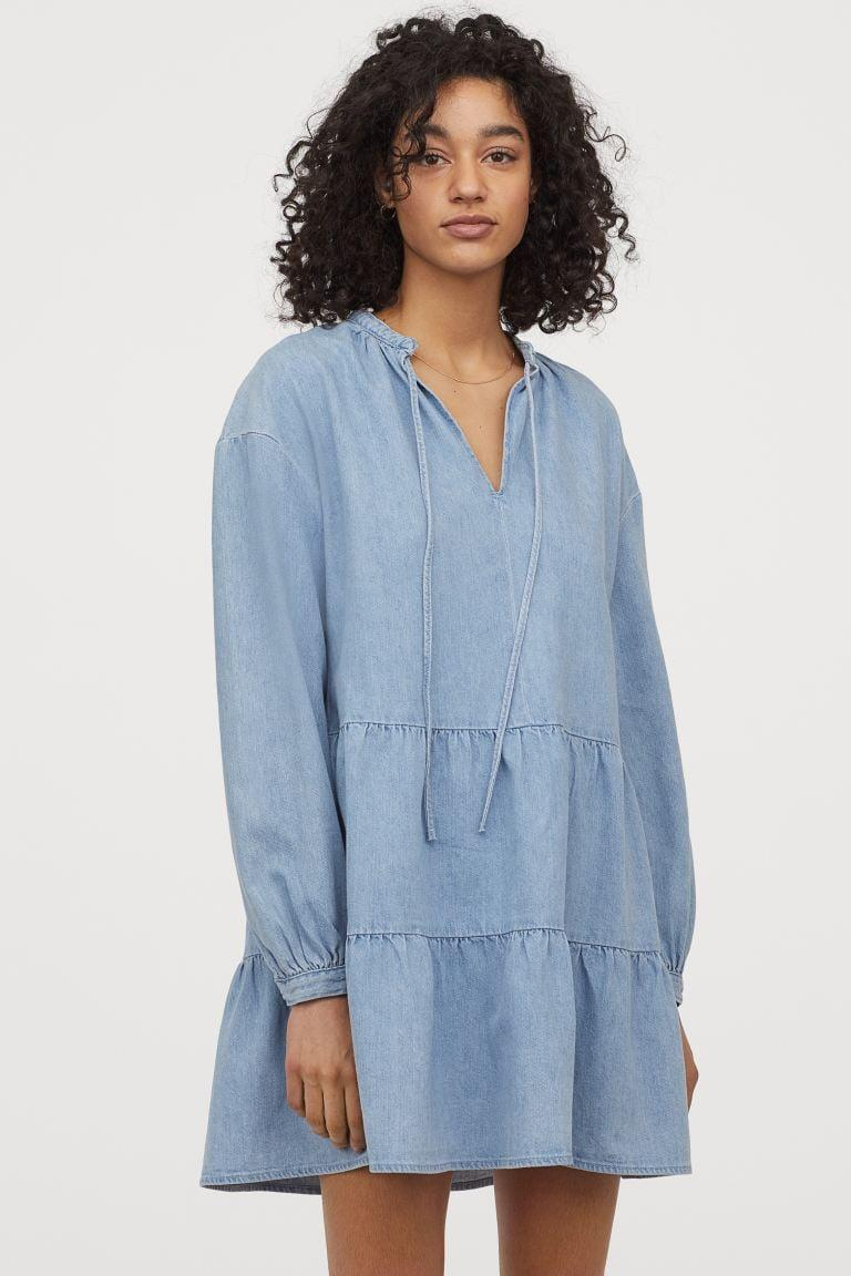 "<p>Stay comfy in this <a href=""https://www.popsugar.com/buy/HampM--line-Denim-Dress-581992?p_name=H%26amp%3BM%20A-line%20Denim%20Dress&retailer=www2.hm.com&pid=581992&price=35&evar1=fab%3Aus&evar9=35329485&evar98=https%3A%2F%2Fwww.popsugar.com%2Ffashion%2Fphoto-gallery%2F35329485%2Fimage%2F47550198%2FHM--line-Denim-Dress&list1=shopping%2Cdenim%2Csummer%20fashion%2Cfashion%20shopping&prop13=mobile&pdata=1"" class=""link rapid-noclick-resp"" rel=""nofollow noopener"" target=""_blank"" data-ylk=""slk:H&amp;M A-line Denim Dress"">H&amp;M A-line Denim Dress</a> ($35).</p>"