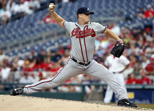 Atlanta Braves starting pitcher Gavin Floyd throws during the second inning of a baseball game against the Washington Nationals at Nationals Park Thursday, June 19, 2014, in Washington. (AP Photo/Alex Brandon)