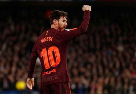 Soccer Football - Champions League Round of 16 First Leg - Chelsea vs FC Barcelona - Stamford Bridge, London, Britain - February 20, 2018. Barcelona's Lionel Messi celebrates scoring their first goal. Action Images via Reuters/Andrew Boyers