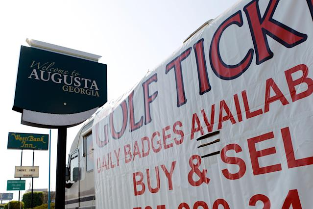 Ticket brokers line the road leading to Augusta National selling tickets for the Masters. (Getty)