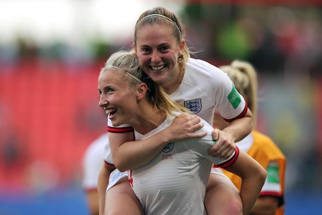 Leah Williamson of England and Keira Walsh of England celebrate victory after the 2019 FIFA Women's World Cup France Round Of 16 match between England and Cameroon at Stade du Hainaut on June 23, 2019 in Valenciennes, France. (Photo by Molly Darlington - AMA/Getty Images)