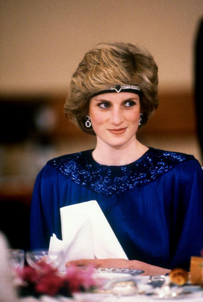 """<p>Princess Diana was fond of turning her <a href=""""https://www.townandcountrymag.com/style/jewelry-and-watches/g35744981/princess-diana-queen-elizabeth-emerald-jewelry-photos/"""" rel=""""nofollow noopener"""" target=""""_blank"""" data-ylk=""""slk:chokers into headbands"""" class=""""link rapid-noclick-resp"""">chokers into headbands</a>, as she did here for a dinner with the emperor of Japan in 1986.</p>"""