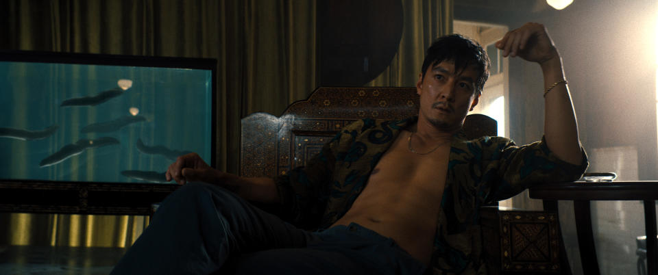 """This image released by Warner Bros. Pictures shows Daniel Wu in a scene from """"Reminiscence."""" (Warner Bros. Pictures via AP)"""