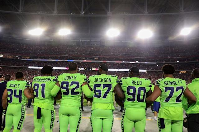 Seattle Seahawks stand during the anthem. (Getty)