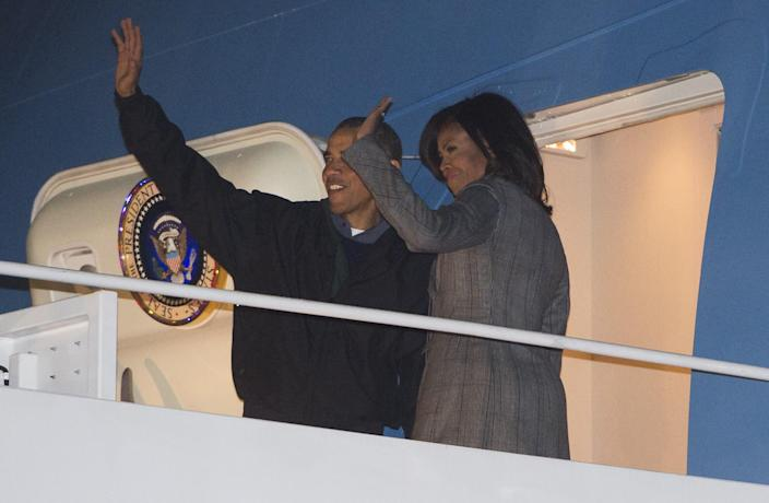 US President Barack Obama and First Lady Michelle Obama board Air Force One on January 24, 2015 as they depart from Andrews Air Force Base in Maryland for a three-day trip to India (AFP Photo/Saul Loeb)