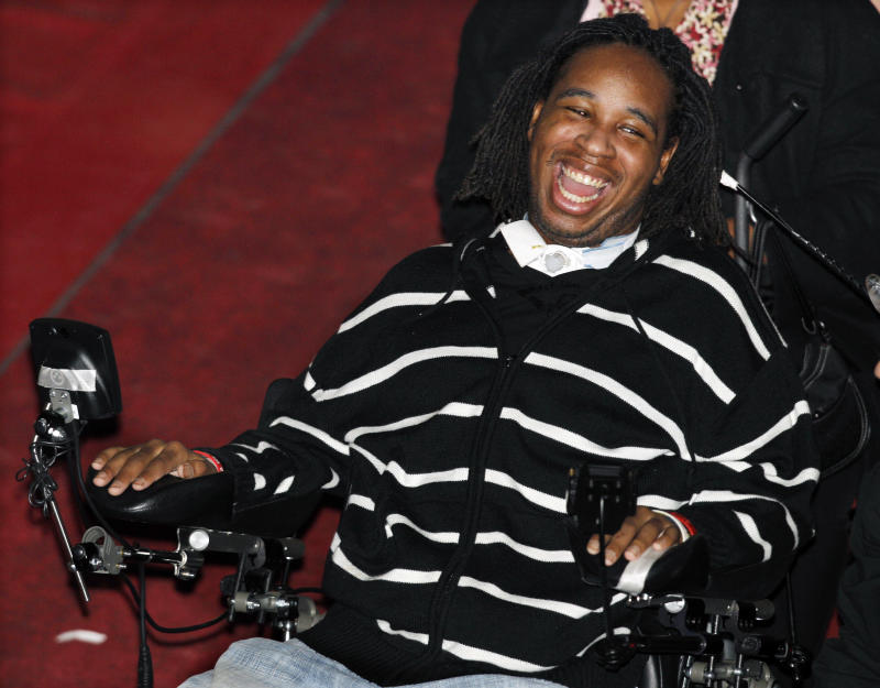 """Former Rutgers football player Eric LeGrand laughs Saturday, Feb. 19, 2011, in Piscataway, N,J., as he attends """"Laugh To Heal Comedy"""" fundraiser for him at Rutgers University. LeGrand was paralyzed from the neck down after making a special teams tackle against Army on Saturday, Oct. 16, 2010. (AP Photo/Mel Evans)"""