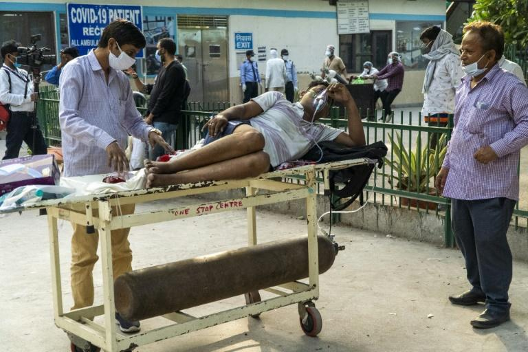 India's surge has seen it add about 350,000 cases and 2,600 deaths a day, and the healthcare system has been pushed to breaking point