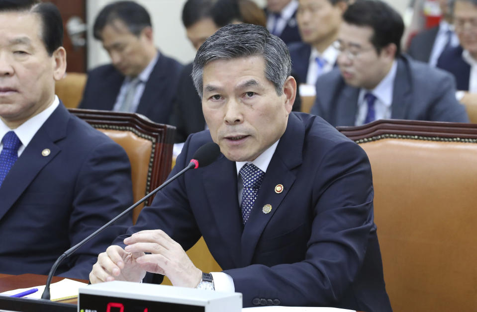South Korean Defense Minister Jeong Kyeong-doo answers a lawmaker's question about North Koreans' deportation during a defense committee meeting at the National Assembly in Seoul, South Korea, Thursday, Nov. 7, 2019. South Korea says it has deported 2 North Koreans after finding they had killed 16 fellow fishermen onboard and fled to South Korea. (Kim Ju-hyung/Yonhap via AP)