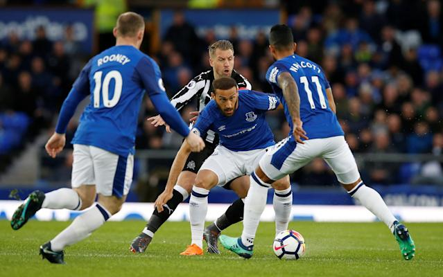 "Soccer Football - Premier League - Everton v Newcastle United - Goodison Park, Liverpool, Britain - April 23, 2018 Everton's Cenk Tosun in action with Newcastle United's Florian Lejeune REUTERS/Andrew Yates EDITORIAL USE ONLY. No use with unauthorized audio, video, data, fixture lists, club/league logos or ""live"" services. Online in-match use limited to 75 images, no video emulation. No use in betting, games or single club/league/player publications. Please contact your account representative for further details."