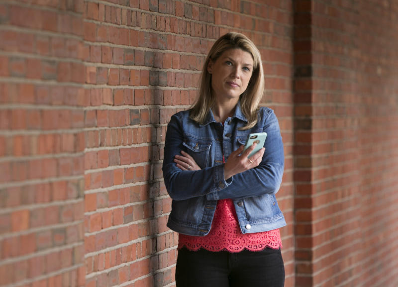 PORTLAND, ME - MAY 12: Kelly McCormack is photographed with her cell phone in Portland on Friday, May 12, 2017. McCormack is annoyed at the increasing number of robocalls she receives on her phone. Data from YouMail Inc., a California-based communications technology firm, show that robocall volume in Maine peaks in the summer and tapers off in the winter. Robocalls to Maine's 207 area code ramped up in April and was even higher than in April 2016. (Staff Photo by Gregory Rec/Portland Portland Press Herald via Getty Images)
