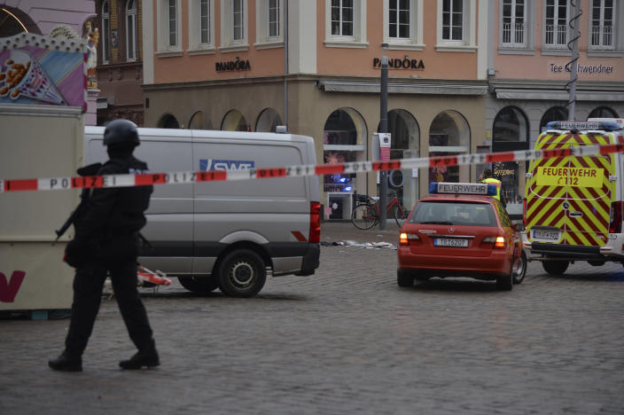 A square is blocked by the police in Trier, Germany, Tuesday, Dec. 1, 2020. German police say two people have been killed and several others injured in the southwestern German city of Trier when a car drove into a pedestrian zone. Trier police tweeted that the driver had been arrested and the vehicle impounded. (Harald Tittel/dpa via AP)