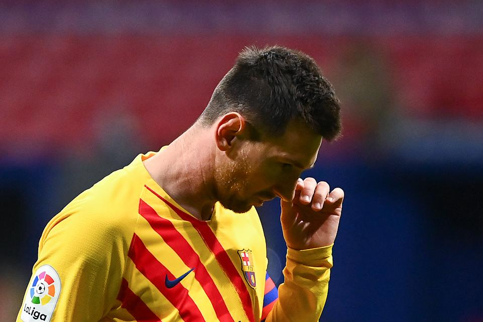 Barcelona's Argentinian forward Lionel Messi reacts after missing a goal opportunity during the Spanish League football match between Club Atletico de Madrid and FC Barcelona at the Wanda Metropolitano stadium in Madrid on November 21, 2020. (Photo by GABRIEL BOUYS / AFP) (Photo by GABRIEL BOUYS/AFP via Getty Images)