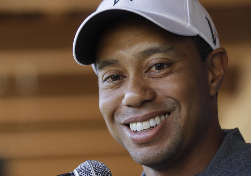 FILE - This Feb. 21, 2012 file photo shows Tiger Woods answering questions during a news conference before playing a practice round at the Match Play Championship golf tournament, in Marana, Ariz. Instead of a news conference before this week's Wells Fargo Championship, Woods answered 19 questions that were submitted through Facebook and Twitter.  (AP Photo/Julie Jacobson, File)