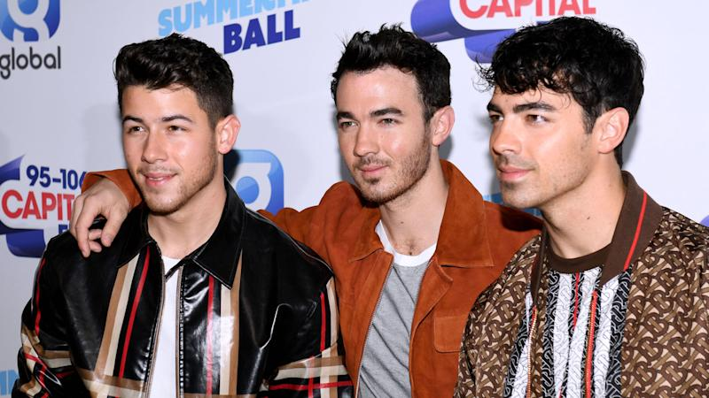 Nick and Joe Jonas celebrate tour kick-off in Miami with wives