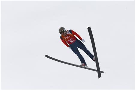 Todd Lodwick of the U.S. soars through the air during the trial round of the large hill ski jumping portion of the Nordic Combined team Gundersen event of the Sochi 2014 Winter Olympic Games, at the RusSki Gorki Ski Jumping Center in Rosa Khutor, February 20, 2014. REUTERS/Michael Dalder