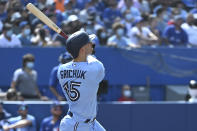 Toronto Blue Jays' Randal Grichuk watches his two-run home run, which also scored Santiago Espinal, in the second inning of a baseball game against the Detroit Tigers in Toronto, Saturday, Aug. 21, 2021. (Jon Blacker/The Canadian Press via AP)