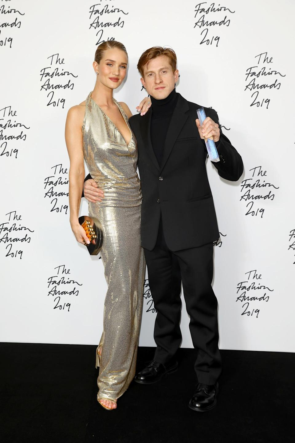 Bottega Veneta's Daniel Lee with model Rosie Huntington-Whiteley, who was wearing one of his designs (Getty Images)