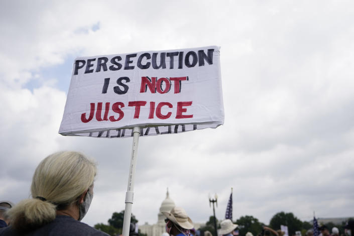 """People attend a rally near the U.S. Capitol in Washington, Saturday, Sept. 18, 2021. The rally was planned by allies of former President Donald Trump and aimed at supporting the so-called """"political prisoners"""" of the Jan. 6 insurrection at the U.S. Capitol. (AP Photo/Brynn Anderson)"""