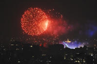 Fireworks light up the sky over the Zocalo during Mexico's Independence Day celebrations in Mexico City, Wednesday, Sept. 15, 2021. (AP Photo/Marco Ugarte)