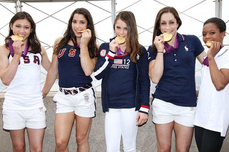This image released by Starpix shows the gold medal-winning US Women's Gymnastics Team, from left, Kyla Ross, Aly Raisman, McKayla Marone, Jordyn Wieber and Gabby Douglas pose on the observation deck of the Empire State Building, Tuesday, Aug. 14, 2012 in New York. (AP Photo/Starpix, Kristina Bumphrey)