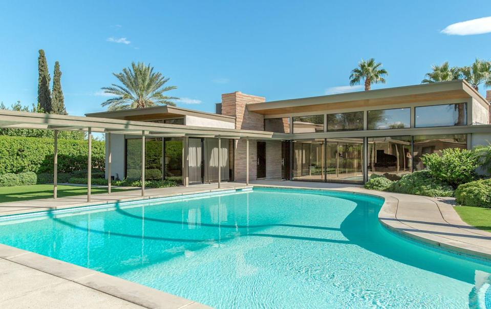 """<p>Come fly with me! You can live it up, Rat Pack style, in this stunning midcentury modern gem, built by architect E. Stewart Williams at the behest of none other than Frank Sinatra in 1947. With four bedrooms, this house can accommodate up to eight guests, and features classic Palm Springs decor (think palm-frond wallpaper and wood paneling) and a sprawling pool with views to the mountains. Pack your caftans and give yourself a getaway worthy of Ol' Blue Eyes.</p><p><a class=""""link rapid-noclick-resp"""" href=""""https://www.airbnb.com/luxury/listing/26152246?source_impression_id=p3_1626459602_9tSlPtWp974hDAMh"""" rel=""""nofollow noopener"""" target=""""_blank"""" data-ylk=""""slk:Book Now"""">Book Now</a></p>"""