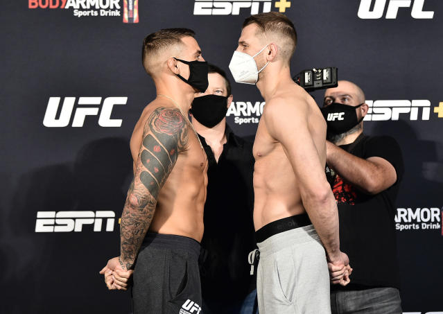 Dustin Poirier (L) and Dan Hooker of New Zealand face off during their weigh-in at UFC APEX on Friday in Las Vegas. (Photo by Chris Unger/Zuffa LLC via Getty Images)