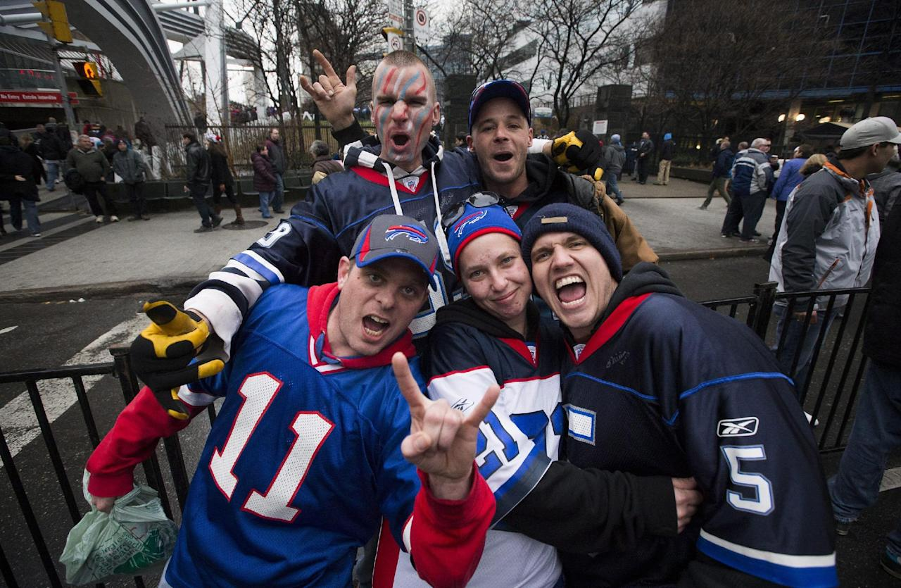 Bills fans cheer before the Buffalo Bills play the Atlanta Falcons in NFL football action in Toronto, Sunday Dec. 1, 2013.  (AP Photo/The Canadian Press, Mark Blinch)