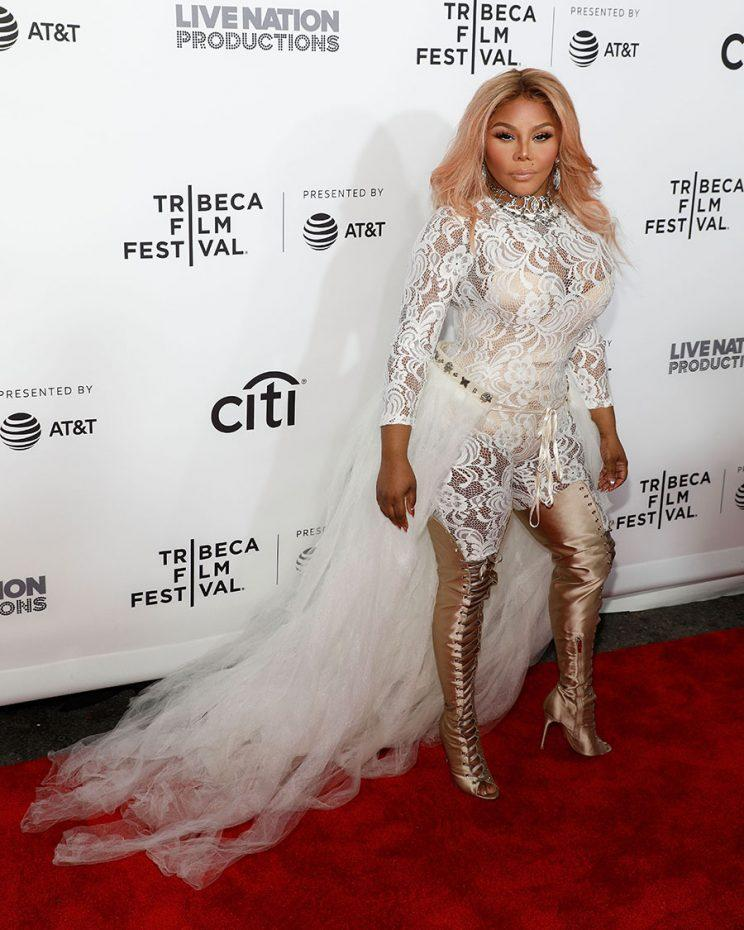 Lil' Kim wears white at the Tribeca Film Festival. (Photo: Getty Images)