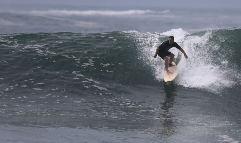 Riding out the pandemic, Rio surfers catch a wave of controversy