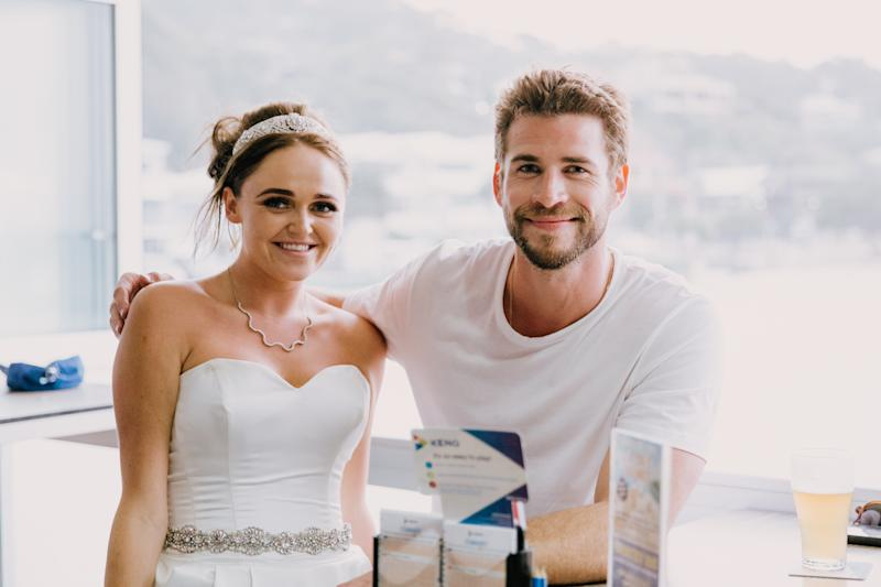 Liam Hemsworth and bride at Currumbin Beach Vikings Surf Life Saving Club