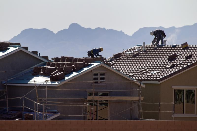 Roofers work on new homes at a residential construction site in the west side of the Las Vegas Valley in Las Vegas