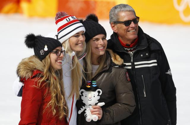 Alpine Skiing - Pyeongchang 2018 Winter Olympics - Women's Downhill - Jeongseon Alpine Centre - Pyeongchang, South Korea - February 21, 2018 - Bronze medallist Lindsey Vonn of the U.S. flanked by her sisters Laura and Karin pose with her father Alan Kildow. REUTERS/Leonhard Foeger