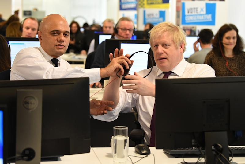 Prime Minister Boris Johnson and Chancellor Sajid Javid with other members of the Cabinet at Conservative Campaign Headquarters Call Centre, London, while on the election campaign trail. (Photo by Stefan Rousseau/PA Images via Getty Images)