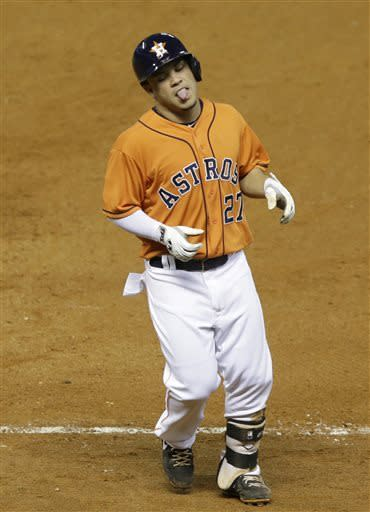 Houston Astros' Jose Altuve heads to the dugout after grounding out to the Texas Rangers pitcher in the fifth inning of a baseball game Friday, May 10, 2013, in Houston. (AP Photo/Pat Sullivan)