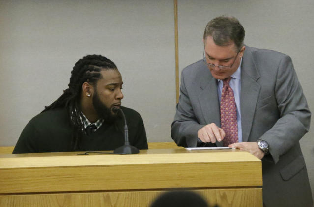 Dallas Cowboys defensive back Danny McCray, left, listens to a question from defense attorney George Milner during the intoxication manslaughter trial of former Cowboys player Josh Brent, Thursday, Jan. 16, 2014, in Dallas. Brent is accused of driving drunk at the time of a Dec. 2012 crash that killed Cowboys practice squad player Jerry Brown. (AP Photo/LM Otero)