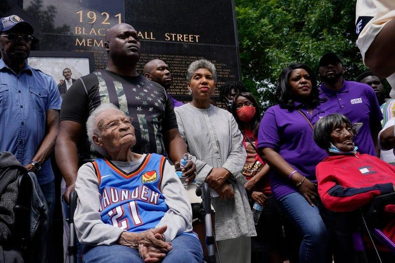 Tulsa race massacre survivors Viola Fletcher, left, and Lessie Benningfield Randle, right, listen during a rally marking centennial commemorations of a two-day assault by armed white men on Tulsa's prosperous Black community of Greenwood, Friday, May 28, 2021, in Tulsa, Okla.