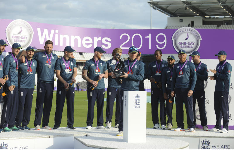 England's captain Eoin Morgan, center, celebrates with the trophy after winning the one day international series against Pakistan at Emerald Headingley in Leeds, England, Sunday, May 19, 2019. (AP Photo/Rui Vieira)