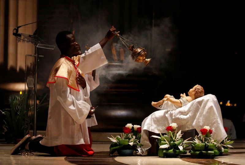 Altar boys attend the celebration of Christmas at the Basilica Notre Dame in Yamoussoukro