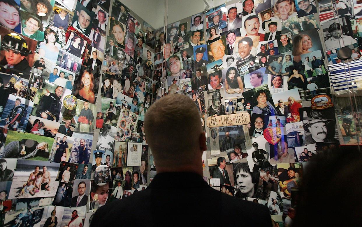 A firefighter looks at photos of 9/11 victims