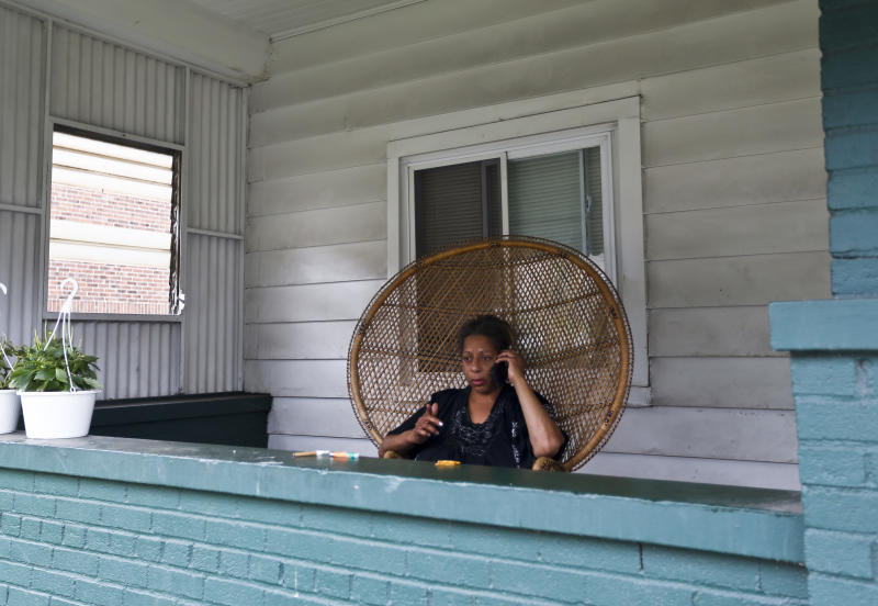 Debra Jones, who said she saw a police officer fatally shoot a 17-year-old boy just seconds after he fled from a traffic stop during a confrontation late the night before, sits on her porch along Grandview Ave. on Wednesday, June 20, 2018, in East Pittsburgh, Pa. (AP Photo/Keith Srakocic)