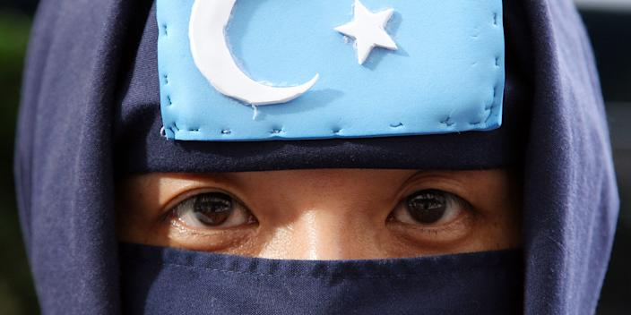 Activist protests in front of Japan National Press Center where Rebiya Kadeer, president of World Uighur Congress, delivered a press conference on July 29, 2009 in Tokyo, Japan.